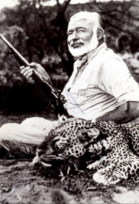 ERNEST HEMINGWAY with leopard he has killed in Uganda, 1/24/54.
